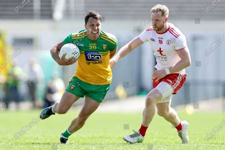 Donegal vs Tyrone. Donegal's Paul Brennan and Frank Burns of Tyrone