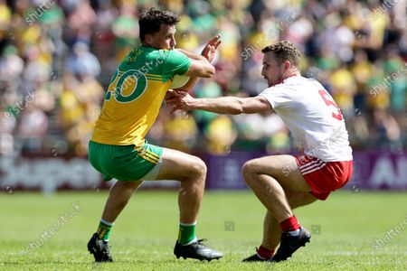 Stock Picture of Donegal vs Tyrone. Donegal's Paul Brennan and Niall Sludden of Tyrone