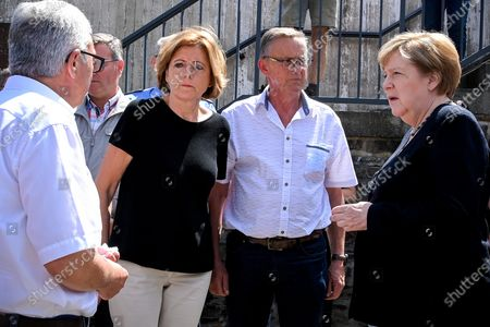 German Chancellor Angela Merkel (R) and Rhineland-Palatinate Prime Minister Malu Dreyer (2-L) arrive for their visit to get an overview of the damage after heavy flooding of the river Ahr caused severe destruction in the village of Schuld, Ahrweiler district, Germany, 18 July 2021. Large parts of western Germany were hit by heavy, continuous rain in the night to 15 July, resulting in local flash floods that destroyed buildings and swept away cars, killing dozens of people, while several were still missing.