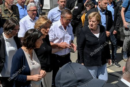 German Chancellor Angela Merkel (C-R) and Rhineland-Palatinate Prime Minister Malu Dreyer (C-L) inspect the damage after heavy flooding of the river Ahr caused severe destruction in the village of Schuld, Ahrweiler district, Germany, 18 July 2021. Large parts of western Germany were hit by heavy, continuous rain in the night to 15 July, resulting in local flash floods that destroyed buildings and swept away cars, killing dozens of people, while several were still missing.