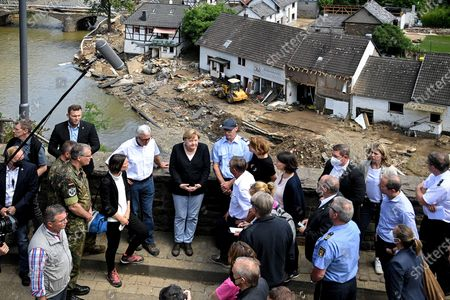 German Chancellor Angela Merkel (C-L) and Rhineland-Palatinate Prime Minister Malu Dreyer (C-R)  inspect the damage after heavy flooding of the river Ahr caused severe destruction in the village of Schuld, Ahrweiler district, Germany, 18 July 2021. Large parts of western Germany were hit by heavy, continuous rain in the night to 15 July, resulting in local flash floods that destroyed buildings and swept away cars, killing dozens of people, while several were still missing.