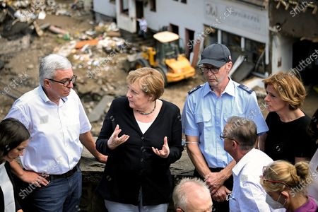 German Chancellor Angela Merkel (C) and Rhineland-Palatinate Prime Minister Malu Dreyer (R) inspect the damage after heavy flooding of the river Ahr caused severe destruction in the village of Schuld, Ahrweiler district, Germany, 18 July 2021. Large parts of western Germany were hit by heavy, continuous rain in the night to 15 July, resulting in local flash floods that destroyed buildings and swept away cars, killing dozens of people, while several were still missing.