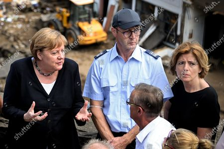 German Chancellor Angela Merkel (L) and Rhineland-Palatinate Prime Minister Malu Dreyer (R) inspect the damage after heavy flooding of the river Ahr caused severe destruction in the village of Schuld, Ahrweiler district, Germany, 18 July 2021. Large parts of western Germany were hit by heavy, continuous rain in the night to 15 July, resulting in local flash floods that destroyed buildings and swept away cars, killing dozens of people, while several were still missing.