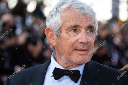 Stock Photo of Michel Boujenah poses for photographers upon arrival at the awards ceremony and premiere of the closing film 'OSS 117: From Africa with Love' at the 74th international film festival, Cannes, southern France