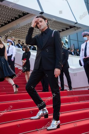 Nicolas Maury poses for photographers upon arrival at the awards ceremony and premiere of the closing film 'OSS 117: From Africa with Love' at the 74th international film festival, Cannes, southern France