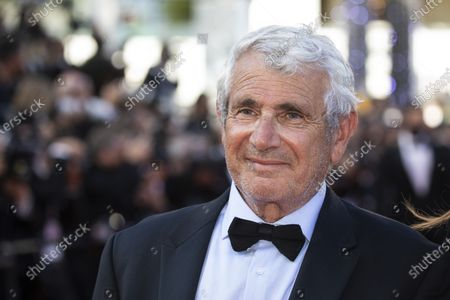 Michel Boujenah poses for photographers upon arrival at the awards ceremony and premiere of the closing film 'OSS 117: From Africa with Love' at the 74th international film festival, Cannes, southern France