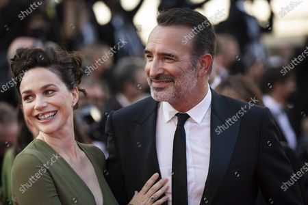 Nathalie Pechalat and Jean Dujardin pose for photographers upon arrival at the awards ceremony and premiere of the closing film 'OSS 117: From Africa with Love' at the 74th international film festival, Cannes, southern France