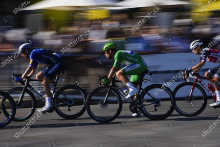 Britain's Mark Cavendish, wearing the best sprinter's green jersey, follows his teammate and main lead-out Denmark's Michael Morkov during the twenty-first and last stage of the Tour de France cycling race over 108.4 kilometers (67.4 miles) with start in Chatou and finish on the Champs Elysees in Paris, France