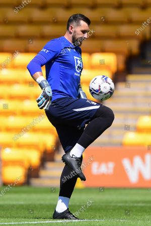 Stock Photo of Nottingham Forest goalkeeper Jordan Smith (12) warms up ahead of kick-off during the Pre-season Friendly match between Port Vale and Nottingham Forest at Vale Park, Burslem on Saturday 17th July 2021.