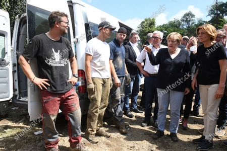 German Chancellor Angela Merkel, 2nd from right, and Malu Dreyer, 1st from right, Prime Minister of Rhineland-Palatinate, talk to victims and helpers during their visit to the flood-damaged village of Schuld near Bad Neuenahr-Ahrweiler, Germany, . After days of extreme downpours causing devastating floods in Germany and other parts of western Europe the death toll has risen