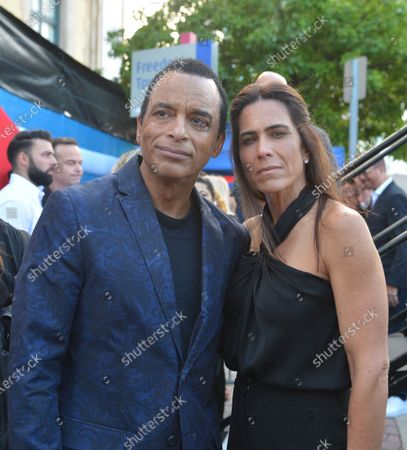 (L-R) Jon Secada and Maritere Vilar attend a Rally For Democracy In Cuba showing support for Cubans demonstrating against their government, at Miami Dade College's Freedom Tower in Miami, on July 17, 2021.