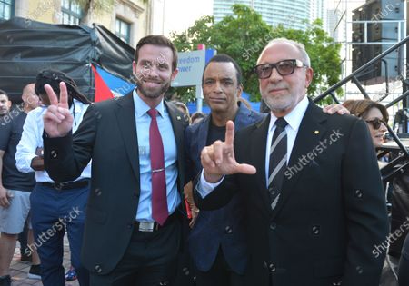 Guest, Jon Secada and Emilio Estefan attend a Rally For Democracy In Cuba showing support for Cubans demonstrating against their government, at Miami Dade College's Freedom Tower in Miami, on July 17, 2021.