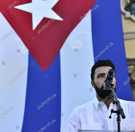 Stock Picture of Jencarlos Canela speaks onstage during a Rally For Democracy In Cuba showing support for Cubans demonstrating against their government, at Miami Dade College's Freedom Tower in Miami, on July 17, 2021.