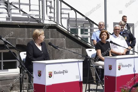 Stock Photo of Flood disaster in Rhineland-Palatinate: Chancellor Angela Merkel with Prime Minister Malu Dreyer during a press statement at the town hall in Adenau after visiting the Eiffel Village Schult, which was severely hit by the underweather disaster