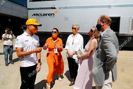 Prince Edward and Sophie Countess of Wessex speak with Lando Norris (left) during a visit to the McLaren team garage at the British Grand Prix in Silverstone.. Before the start of the race at Silverstone, Edward and Sophie met McLaren drivers and their team which is joining forces with the DofE to encourage the public to take part in the charity's new fundraising challenge Do It 4 Youth.