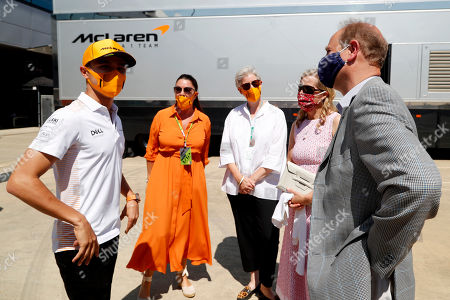 Stock Photo of Prince Edward and Sophie Countess of Wessex speak with Lando Norris (left) during a visit to the McLaren team garage at the British Grand Prix in Silverstone.. Before the start of the race at Silverstone, Edward and Sophie met McLaren drivers and their team which is joining forces with the DofE to encourage the public to take part in the charity's new fundraising challenge Do It 4 Youth.
