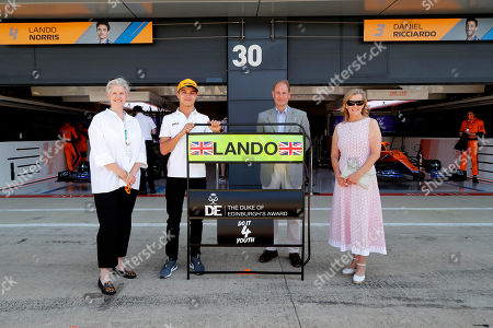 Prince Edward and Sophie Countess of Wessex with Lando Norris (centre left) during a visit to the McLaren team garage at the British Grand Prix in Silverstone.. Before the start of the race at Silverstone, Edward and Sophie met McLaren drivers and their team which is joining forces with the DofE to encourage the public to take part in the charity's new fundraising challenge Do It 4 Youth.