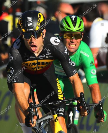 Belgian rider Wout Van Aert (L) of Team Jumbo Visma crosses the finish line to win the 21st stage of the Tour de France 2021 over 108.4 km from Chatou to Paris, France, 18 July 2021. At right British rider Mark Cavendish of the Deceuninck Quick-Step team.