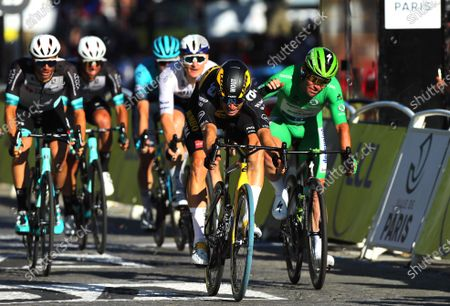 Belgian rider Wout Van Aert (2-R) of Team Jumbo Visma crosses the finish line to win the 21st stage of the Tour de France 2021 over 108.4 km from Chatou to Paris, France, 18 July 2021. At right British rider Mark Cavendish of the Deceuninck Quick-Step team.