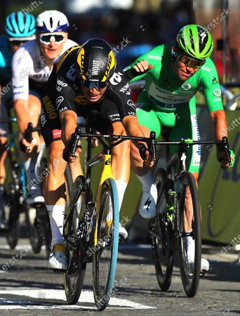 Belgian rider Wout Van Aert (C) of Team Jumbo Visma crosses the finish line to win the 21st stage of the Tour de France 2021 over 108.4 km from Chatou to Paris, France, 18 July 2021. At right British rider Mark Cavendish of the Deceuninck Quick-Step team.