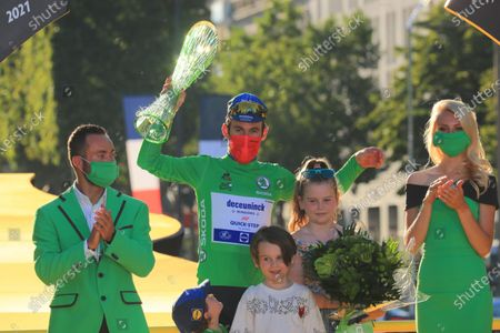 British rider Mark Cavendish of the Deceuninck Quick-Step team celebrates on the podium wearing the green jersey after  the 21st stage of the Tour de France 2021 over 108.4 km from Chatou to Paris, France, 18 July 2021.