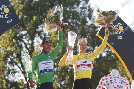 British rider Mark Cavendish (L) of the Deceuninck Quick-Step team and Slovenian rider Tadej Pogacar of the UAE-Team Emirates celebrate on the podium after the 21st stage of the Tour de France 2021 over 108.4 km from Chatou to Paris, France, 18 July 2021.