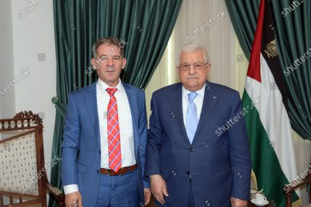 Palestinian President Mahmoud Abbas meets with ahead of the anti-corruption commission, Raed Radwan in the West Bank city of Ramallah on July 18, 2021.