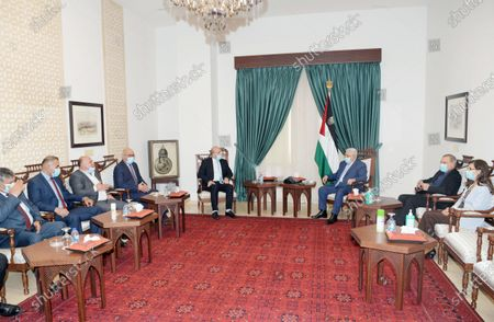 Palestinian President Mahmoud Abbas meets with chairman of the Political and Moral Guidance Authority, Talal Dwaikat in the West Bank city of Ramallah on July 18, 2021.