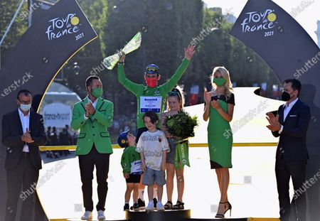 British Mark Cavendish of Deceuninck - Quick-Step celebrates on the podium in the green jersey of leader in the sprint ranking after the 21 and last stage of the 108th edition of the Tour de France cycling race, 108,4 km from Chatou to Paris in France, Sunday 18 July 2021. This year's Tour de France takes place from 26 June to 18 July 2021.