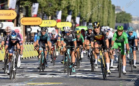 Belgian Wout Van Aert of Team Jumbo-Visma (2R) wins before Belgian Jasper Philipsen of Alpecin-Fenix (L) and British Mark Cavendish of Deceuninck - Quick-Step (R) the sprint at the finish of the 21 and last stage of the 108th edition of the Tour de France cycling race, 108,4 km from Chatou to Paris in France, Sunday 18 July 2021. This year's Tour de France takes place from 26 June to 18 July 2021.