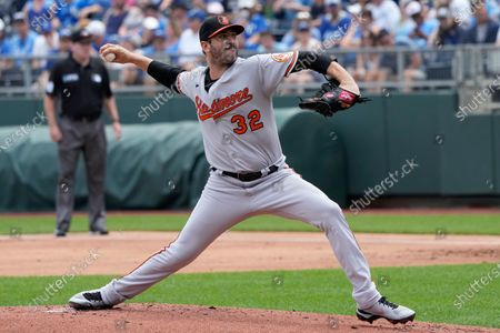 Baltimore Orioles starting pitcher Matt Harvey delivers to a Kansas City Royals batter during the first inning of a baseball game at Kauffman Stadium in Kansas City, Mo