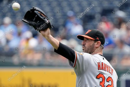 Baltimore Orioles starting pitcher Matt Harvey receives a ball after an out in the first inning of the team's baseball game against the Baltimore Orioles at Kauffman Stadium in Kansas City, Mo