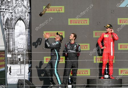 Stock Picture of Lewis Hamilton (GBR), Mercedes AMG Petronas W12 celebrates winning the Formula 1 Pirelli British Grand Prix Race by throwing the trophy in the air at Silverstone