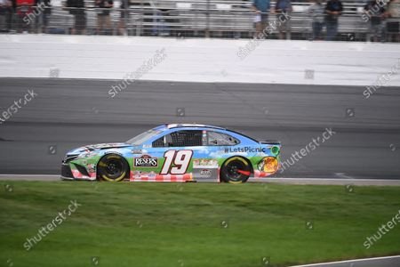 Martin Truex Jr., driver of the (19) Resers Fine Foods #LETSPICNIC Toyota Camry, drives his damaged car in the rain at the NASCAR Cup Series Foxwoods 301 held at the New Hampshire Motor Speedway in Loudon, New Hampshire