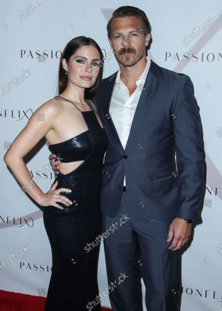 Stock Picture of Actress Olivia Applegate and actor Michael Roark arrive at the Los Angeles Premiere Of Passionflix's Series 'Driven' Season 2 held at AMC Santa Monica 7
