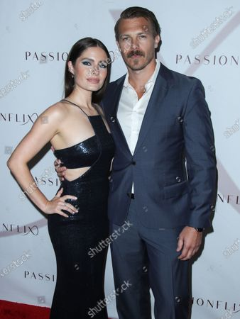 Stock Image of Actress Olivia Applegate and actor Michael Roark arrive at the Los Angeles Premiere Of Passionflix's Series 'Driven' Season 2 held at AMC Santa Monica 7