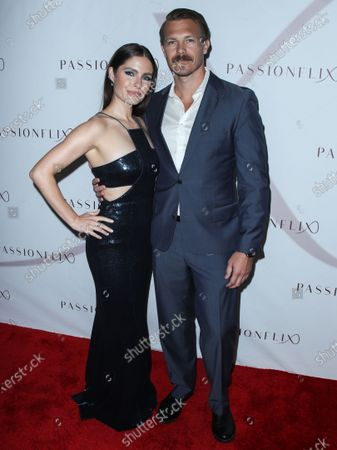 Actress Olivia Applegate and actor Michael Roark arrive at the Los Angeles Premiere Of Passionflix's Series 'Driven' Season 2 held at AMC Santa Monica 7