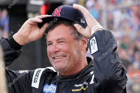 Michael Waltrip waits for the start of an SRX Series auto race, in Nashville, Tenn