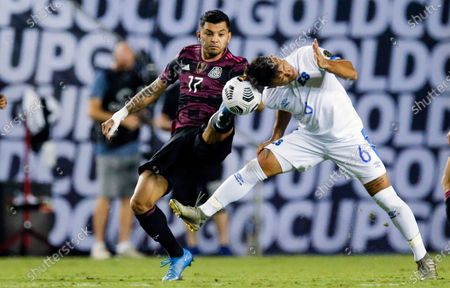 Mexico forward Jesus Corona (17) and El Salvador midfielder Narciso Orellana (6) vie for the ball during a CONCACAF Group A soccer match, in Dallas