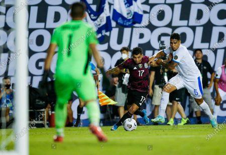 Mexico forward Jesus Corona (17) battles El Salvador defender Ronald Gomez (5) for space during a CONCACAF Group A soccer match, in Dallas. Mexico won 1-0