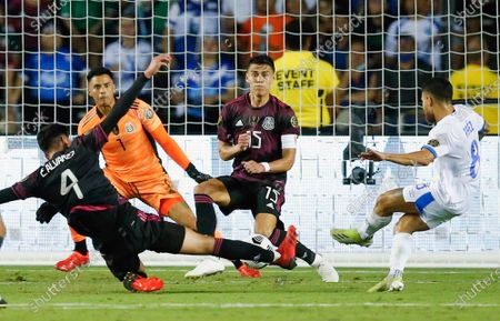 Mexico defender Hector Moreno (15) blocks a shot by El Salvador forward Joshua Perez (8) during a CONCACAF Group A soccer match, in Dallas. Mexico won 1-0