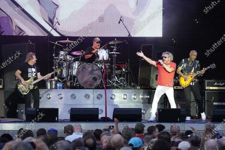Stock Image of Michael Anthony, from Left, Jason Bonham, Sammy Hagar and Vic Johnson perform at RiverEdge Park in Aurora, Ill