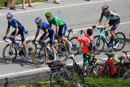 Stock Image of The Belgian Dries Devenyns and the Dane Michael Morkov, from Deceuninck-Quick-Step, Michael SchSr, the Swiss cyclist from AG2R Citroen Team, and the Norwegian Amund Grondahl Jansen, from Team BikeExchange, going up the Port dÕEnvalira pass, the highest paved road in the Pyrenees and the highest pass of this year edition.