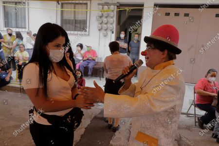 Stock Picture of Evelyn García, mother of Nicolás, a 6-year-old boy who suffers from Hyper IgM Syndrome and requires a bone marrow transplant surgery during the COVID-19 health emergency and the yellow epidemiological traffic light in Mexico City, received money from Pipucho, a clown who offered a show in support of the family at a kermesse in the colonia Miguel Hidalgo, Tláhuac. They need to raise around $600,000 Mexican pesos to carry out the operation.