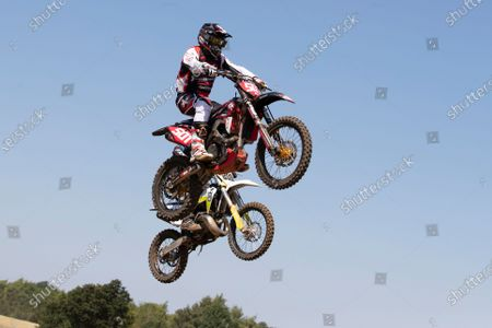 Tim Clark (501) and Peter Hook leap across the start finish jump at Wakes Colne during the Richard Fitch Memorial Trophy Motocross at Wakes Colne MX Circuit on 18th July 2021