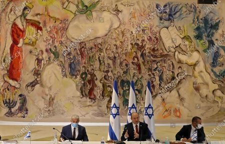 Israeli Prime Minister Naftali Bennett (C) chairs the weekly cabinet meeting, as Alternate Prime Minister and Foreign Minister Yair Lapid (L) looks on in Jerusalem, 19 July 2021.