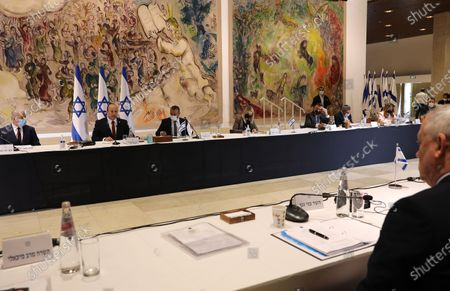 Israeli Prime Minister Naftali Bennett (2-L) chairs the weekly cabinet meeting, as Alternate Prime Minister and Foreign Minister Yair Lapid (L) looks on in Jerusalem, 19 July 2021.