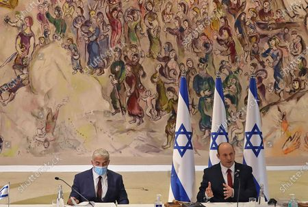 Israeli Prime Minister Naftali Bennett, right, chairs the weekly cabinet meeting at the Knesset in Jerusalem, while Alternate Prime Minister and Foreign Minister Yair Lapid looks on