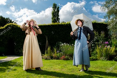 Museum assistant Rebecca Wood and poet-in-residence Ellora Sutton wear traditional regency dresses and bonnets paired with trainers and boots to encourage DIY regency fashion during preparations ahead of the 204th anniversary of the death of Jane Austen at the Jane Austen's House Museum in Chawton near Alton, Hants.   Across the weekend the Jane Austen House Museum will be hosting an array of events to mark the anniversary of the death of Jane Austen on July 18th, including a guided tour through the village of Chawton, Mrs Eltonâ€s Strawberry Picnic in the gardens of the house and a Dress Up Day, where members of the public are invited to try and dress in regency fashion.