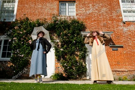 Poet-in-residence Ellora Sutton and Museum assistant Rebecca Wood wear traditional regency dresses and bonnets paired with trainers and boots to encourage DIY regency fashion during preparations ahead of the 204th anniversary of the death of Jane Austen at the Jane Austen's House Museum in Chawton near Alton, Hants.   Across the weekend the Jane Austen House Museum will be hosting an array of events to mark the anniversary of the death of Jane Austen on July 18th, including a guided tour through the village of Chawton, Mrs Eltonâ€s Strawberry Picnic in the gardens of the house and a Dress Up Day, where members of the public are invited to try and dress in regency fashion.